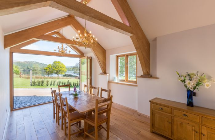 The Great Barn: Dining room with folding doors opening onto Lake View terrace