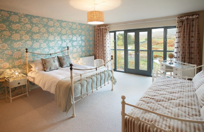 First floor: Double bedroom with 5' bed and day bed for occasional use, with en-suite shower room