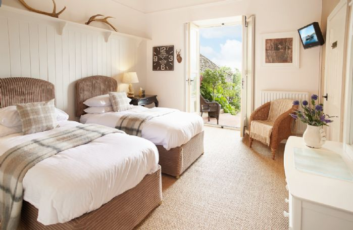 Ground floor: Large twin bedroom with 3' single beds which can convert to a 6' double on request