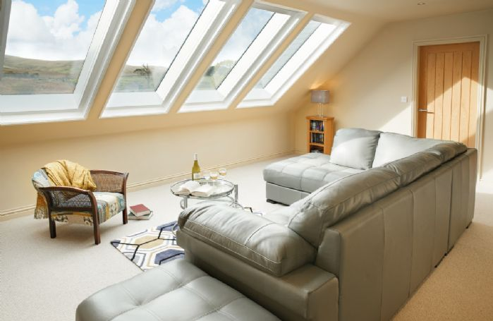 First floor: Open plan sitting room with tv
