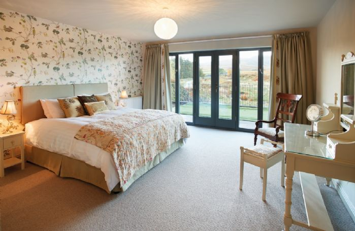 Ground floor: Double bedroom with 6' bed (can be made into singles on request)
