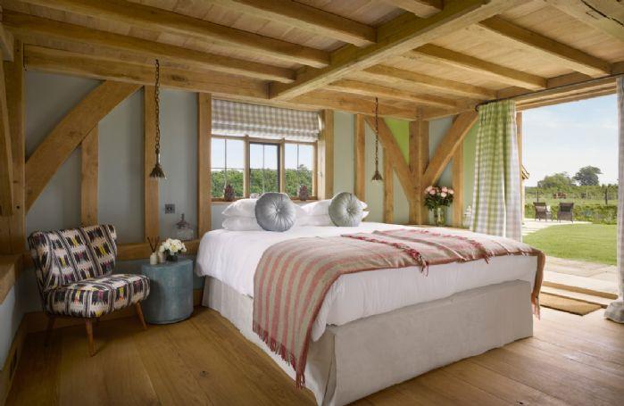 Ground floor: With patio doors to garden and en-suite shower room