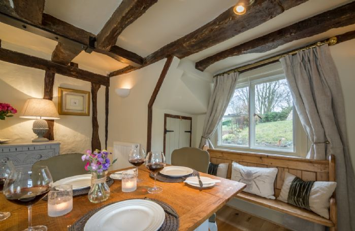 Ground floor: Dining room with exposed beams and garden views