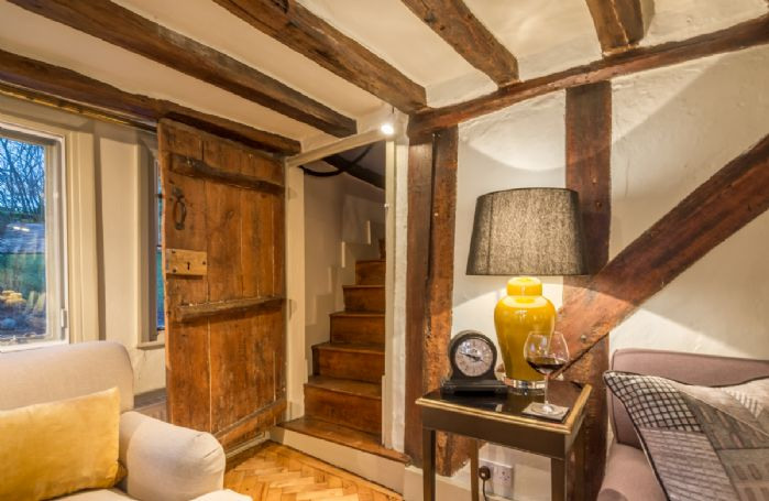 Thatcher's Cottage has two staircases which each lead to a double bedroom upstairs