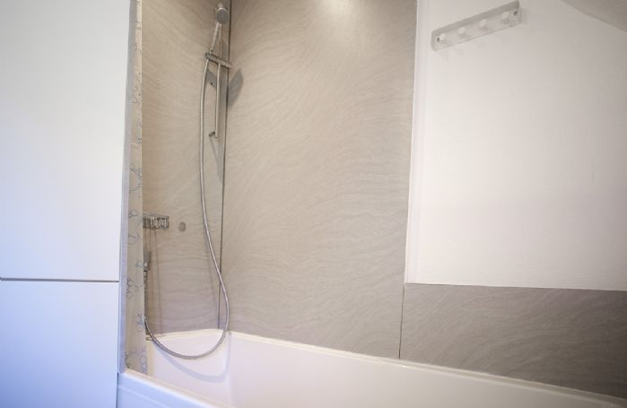 First floor:  Shower over bath