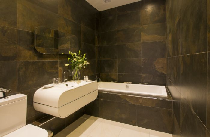 Ground floor: Beautiful family bathroom with spa bath and hand-held shower attachment