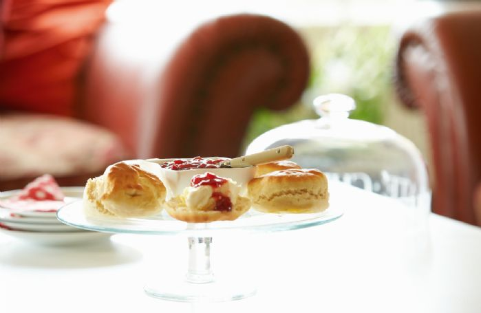 Take tea and scones in the light and airy sitting room