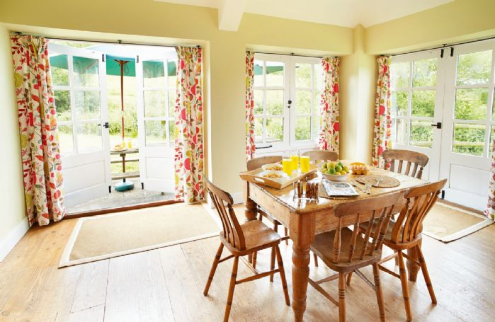 Ground floor:  Dining area of large, farmhouse kitchen