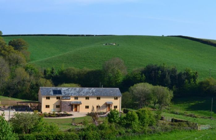 The Farmhouse is tucked away in a gentle, secluded valley surrounded by traditional Devon farmland and set within its own landscaped garden