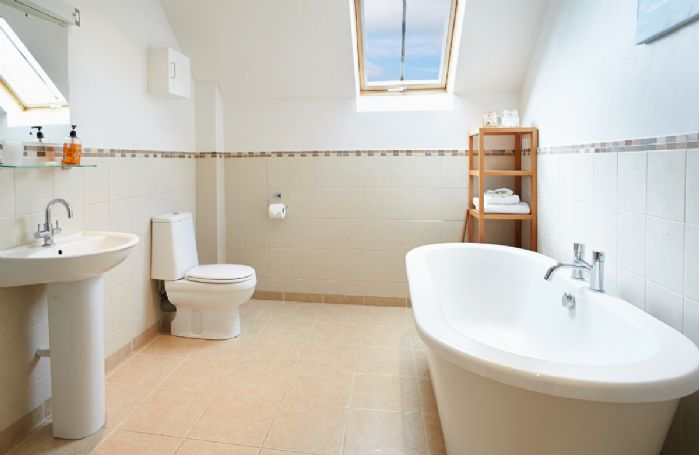 Harvest Moon First floor:  Large family bathroom with a free-standing bath and separate shower
