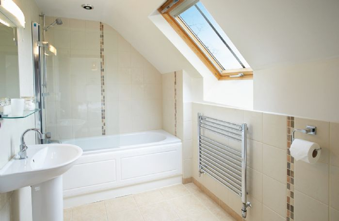 Hunters Moon First floor:  En-suite bathroom with shower over bath