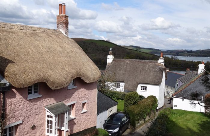 Quicks Cottage is a Grade II listed thatched cottage in a quiet lane close to the church and village stores and pub