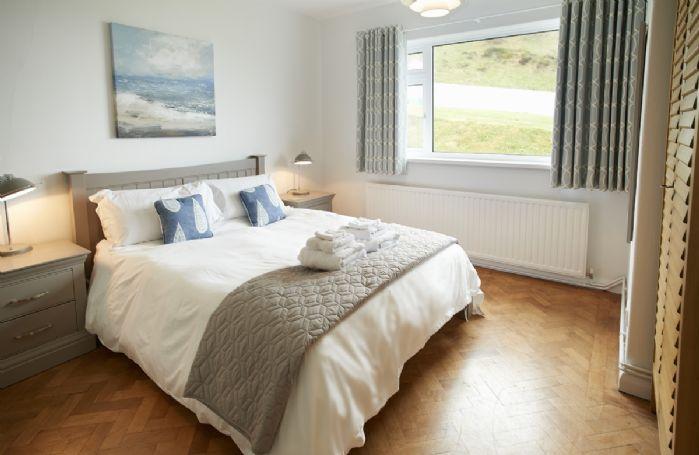 Ground floor: Master bedroom with 5' bed