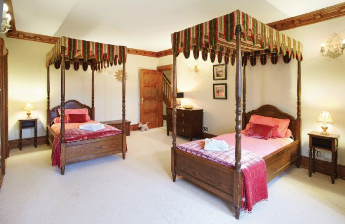 Lower ground floor:  Twin four poster 3' beds