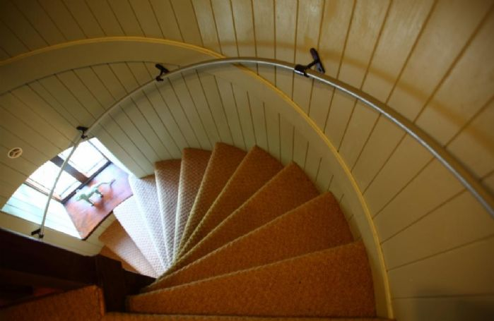 Spiral staircase to tower bedrooms and tower lookout