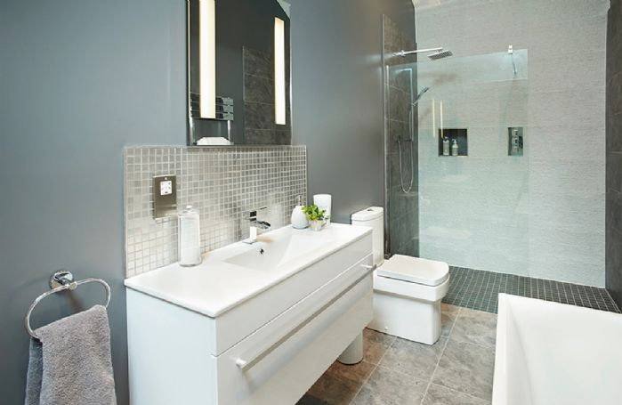Ground floor:  Separate bathroom with underfloor heating, walk in shower and bath