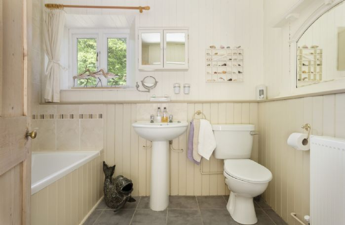 First floor:  Family bathroom with shower over the bath and wc