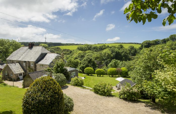 Bittadon Cottage is situated in an elevated position overlooking the valley and surrounded by stunning farmland