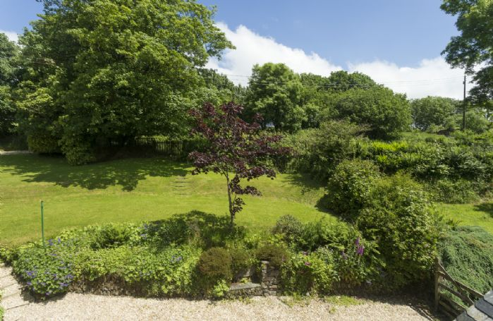 Bittadon Cottage is surrouded by beautiful gardens