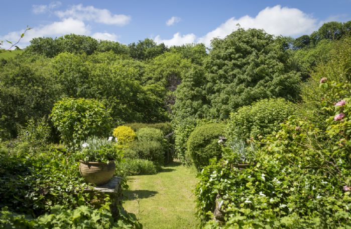 Situated in an elevated position overlooking the valley the cottage is surrounded by manicured gardens