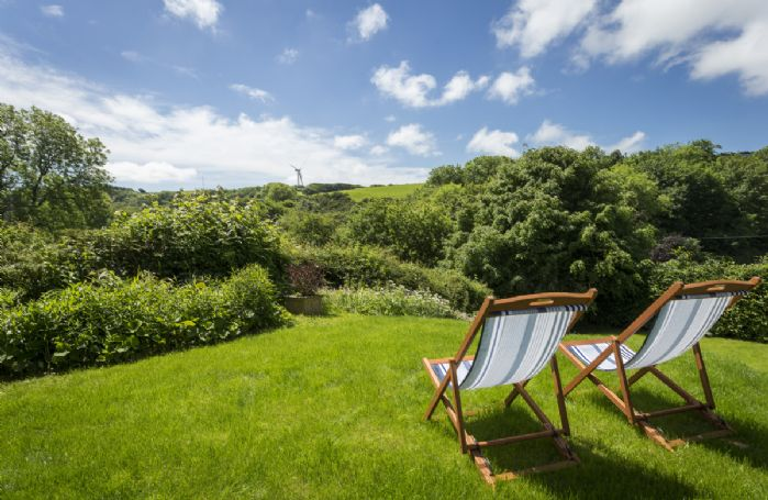 Sit and relax in the deck chairs overlooking the spectacular countryside views