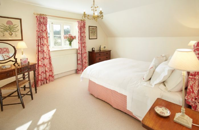 First floor: Master bedroom with king size 5' bed and dressing table