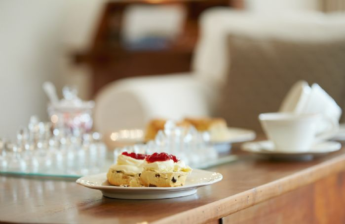 Enjoy a delicious Devonshire cream tea in the comfort of the cottage