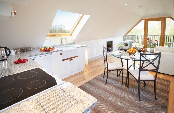 First floor: Open plan kitchen/dining room/sitting room