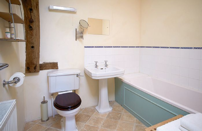 First floor: En-suite bathroom with shower attachment