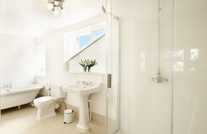 First floor: Large en-suite bathroom with shower and separate Victorian style bath