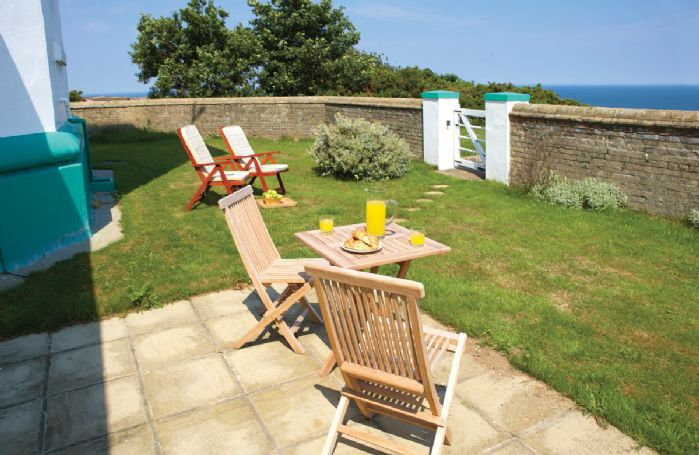 Walled garden with views of the sea