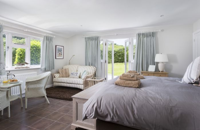 Ground floor: Double bedroom with french doors leading out to the garden