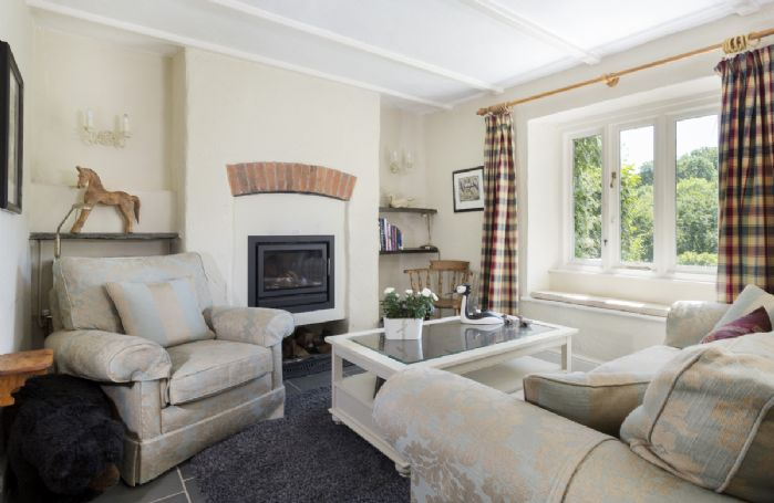 Ground floor: Large family room to relax and enjoy the cosy wood burning stove