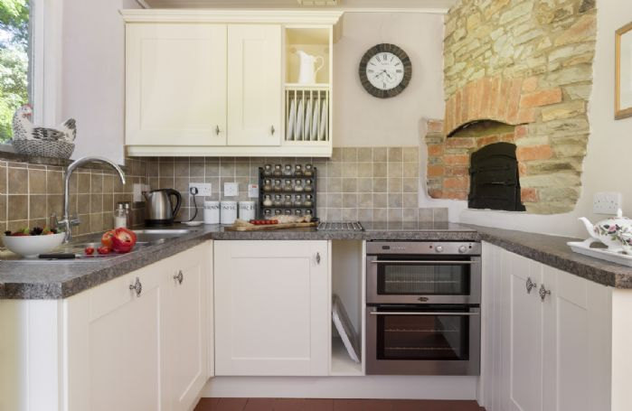 Ground Floor: Contemporary kitchen with electric ceramic hob and double oven, microwave, dishwasher, washer/dryer, walk in larder with fridge/freezer