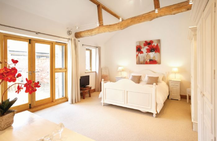 Ground floor:  Double bedroom with 6' bed with en-suite bathroom with separate shower