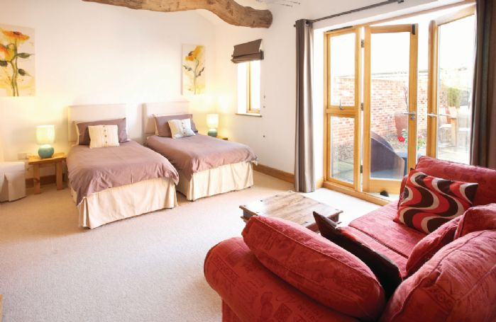 Ground floor:  Double bedroom with 6' zip and link bed which can convert to two single beds on request