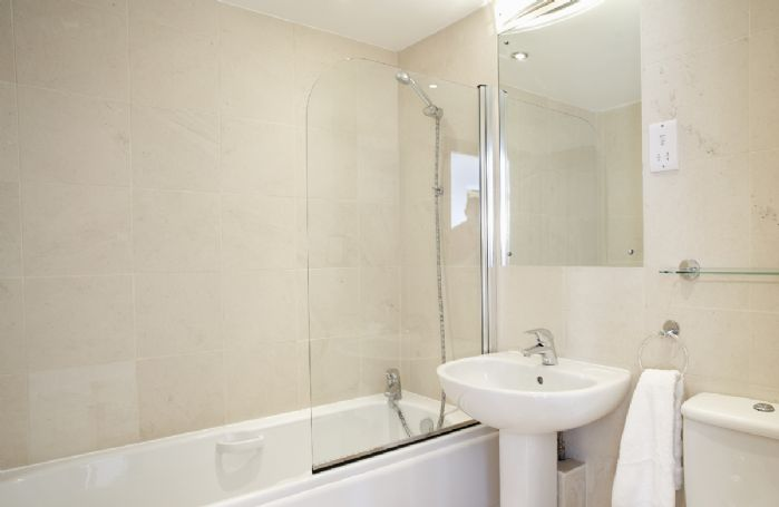 Ground floor:  En-suite bathroom with shower over bath