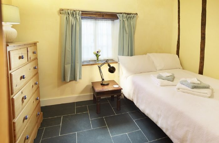 Ground floor: Second double bedroom with 4' bed