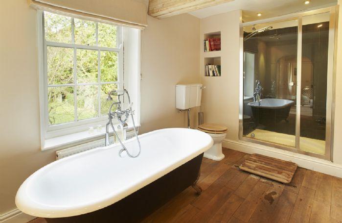 First floor:  Master en-suite bathroom with shower
