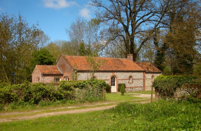 The Engine House is set behind the farmhouse and Norfolk barns of Silverstone Farm