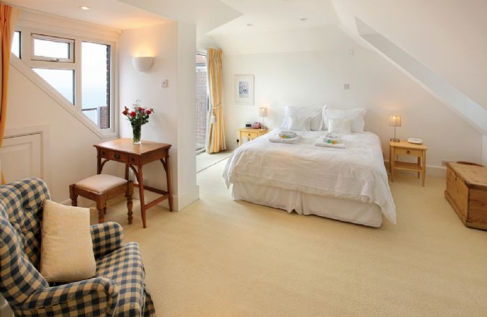 First floor: Double bedroom with 6' super king-size zip/link bed with en suite shower room and decking area