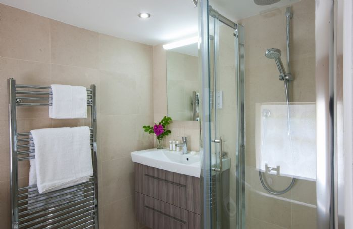 First floor: Family bathroom with separate bath and shower