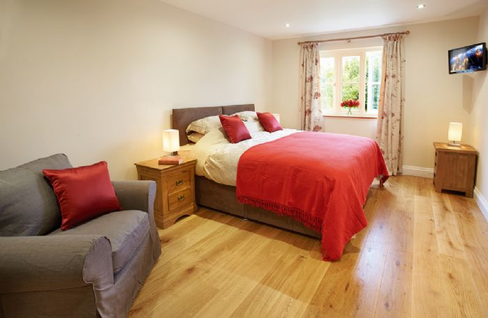 Ground floor:  Double bedroom with 6' zip and link bed which can convert into two single 3' beds upon request