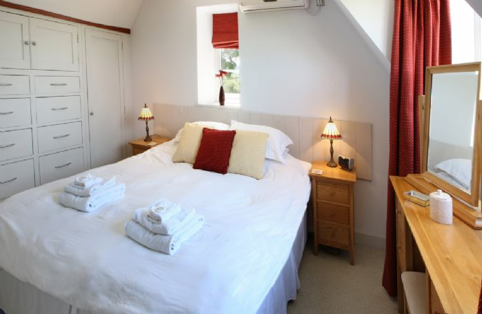 First floor:  Double bedroom with 3' single beds which can convert to 6' double