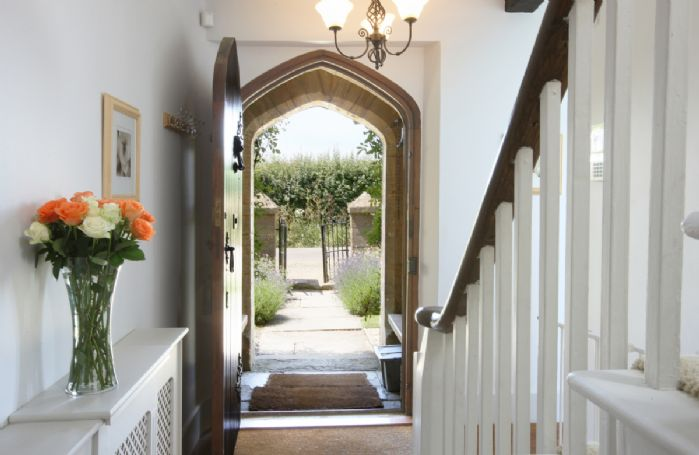 The stunning entrance hall with arched door