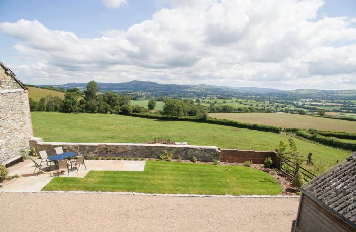 Breath-taking unspoilt views across the valley towards the Kerry Ridgeway and Shropshire Hills