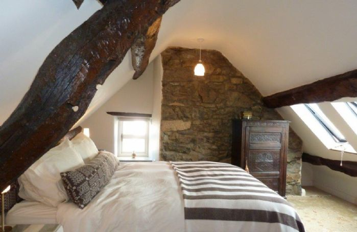 Second floor:  Mezzanine double bedroom suite with en-suite shower room and views of Conwy Castle