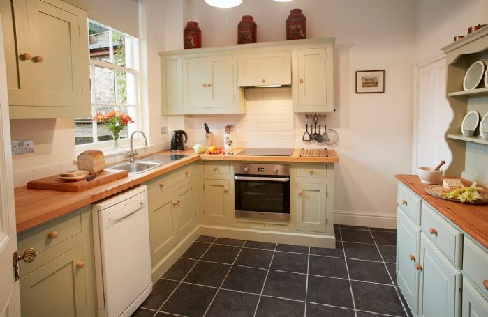 Ground floor: The kitchen is painted a pretty Wedgwood green with matching Denby and Wedgwood china