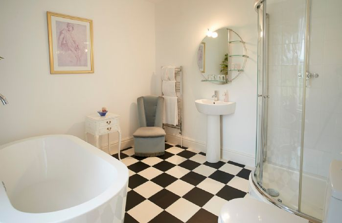 First floor: The second bedroom has an en-suite bathroom with free-standing bath and separate corner shower