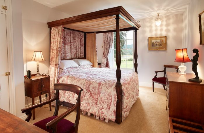First floor: Master bedroom with antique mahogany 5' king size four poster bed